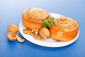 Two cinnamon rolls on plate — Stock Photo