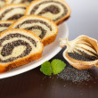 Stock Photo: Macro of Poppy seed roll slices and half pod
