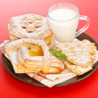Foto Stock: Various cakes and milk breakfast