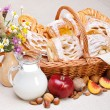 Sweet cakes in basket, fruit and milk decoration — Stock Photo #19518889