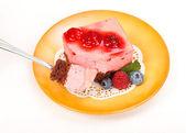 Raspberry yoghurt cake garnished with berries — Stock Photo