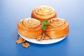 Three cinnamon rolls on plate — Stock Photo