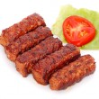 Grilled romanian meat rolls - mititei, mici — Stock Photo