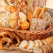 Various baked products in wicker basket — Stock Photo #19665019