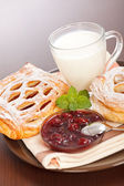 Sour cherry cake, jam and milk — Stock Photo
