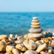 Stacked pebbles on the sea side — Stock Photo