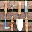 Gardening tools on wood board — Stock Photo