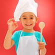 Cheerful little chef showing good taste — Stock Photo