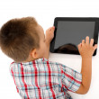 Little boy playing on tablet PC — Stock Photo