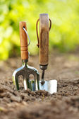 Garden tools stuck in soil — Stock Photo
