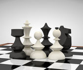 Chess pieces on the chessboard — Stock Photo