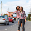 Stock Photo: Girls hitch-hiking