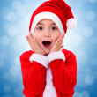 Stock Photo: Surprised Christmas boy wondering