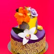 Stock Photo: Colorful cake decorated with candy flowers and lace