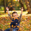 Playing with leaves in autumn — Stock Photo