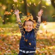 Happy boy with autumn leaves — Stock Photo