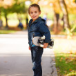 Kid playing outdoors with skateboard — Stock Photo #33319931