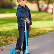 Kid with scooter — Stock Photo