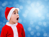 Surprised Christmas boy wondering — Stock Photo
