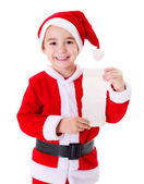 Little Santa Claus boy showing wish list — Stock Photo