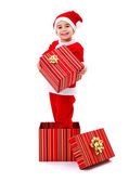 Little Santa Claus boy holding gift — Stock Photo