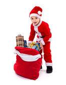 Santa jongetje met geschenk tas — Stockfoto