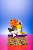 Colorful cake decorated with candy flowers and lace — Stock Photo