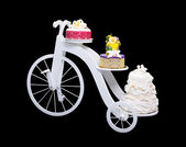 Unique bicycle cake stand with three cakes — Stock Photo