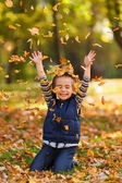 Happy boy with autumn leaves — Foto Stock