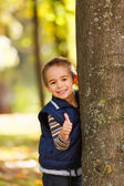 Thumbs up from cute boy — Stock Photo