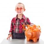 Boy Saving Money — Stock Photo #33786501