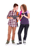 Teens with mobile devices — Stock Photo