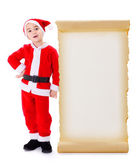 Little Santa Claus standing near big wish list — Stock Photo