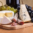 Camembert, blue cheese and dry sausage snack — Stock Photo