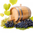 Stock Photo: White and blue grape clusters around barrel
