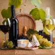 Stock Photo: Red wine with cheese and blue grape snack