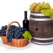 Stock Photo: White and blue grape in basket with barrel