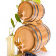 Stock Photo: White wine in front of stacked barrels
