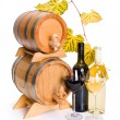 Stock Photo: White and red wine in front of stacked barrels