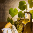 White wine with grape and cheese snack — Stock Photo #34174689