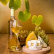 White wine with grape and cheese snack — Stock Photo #34174729
