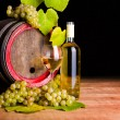 White wine and grapes in front of old barrel — Stock Photo #34174765