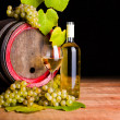 Stock Photo: White wine and grapes in front of old barrel