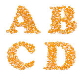 Capital characters made of corn seeds — Stock Photo