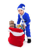 Little blue Santa boy with gift bag — Stock Photo