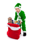 Little green Santa Claus boy with gift bag — Stock Photo