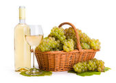 White wine and ripe white grape in basket — Stock Photo