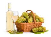 White wine and ripe white grape in basket — Stock Photo