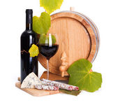 Red wine with cheese snack and little barrel — Stok fotoğraf