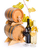 White and red wine in front of stacked barrels — Stock Photo